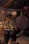A shaman ges into  trance inside a Tsaatan family ger<br />(Yurt )  in Northern outer Mongolia/Russian border.
