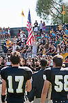 Palos Verdes, CA 09/09/11 - Matt Imwalle (Peninsula #17) and Joey Augello (Peninsula #58) face the flag during the playing of the national anthem before the game against North Torrance.