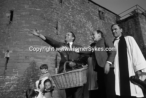 Bread Cheese throwing annual festival at St Mary's church St Briavels  Gloucestershire England.1971  Forester Keith Creswick,and son Gerald. Local vicar. Forest of Dean