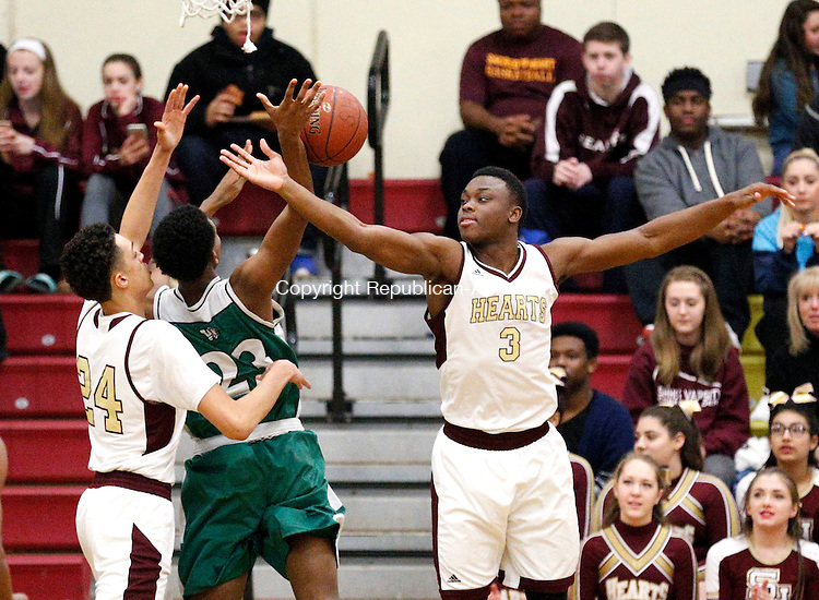 Waterbury, CT-12 February 2016-021216CM07- Wilby's Ammad Alves (23) loses the control of the ball as he's defended by Sacred Heart's Tyrn Flowers (24) and Mustapha Heron (3) during their NVL matchup in Waterbury on Friday night.  Christopher Massa Republican-American
