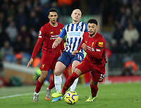 30th November 2019; Anfield, Liverpool, Merseyside, England; English Premier League Football, Liverpool versus Brighton and Hove Albion; Alex Oxlade-Chamberlain of Liverpool wins the ball from Aaron Mooy of Brighton and Hove Albion - Strictly Editorial Use Only. No use with unauthorized audio, video, data, fixture lists, club/league logos or 'live' services. Online in-match use limited to 120 images, no video emulation. No use in betting, games or single club/league/player publications