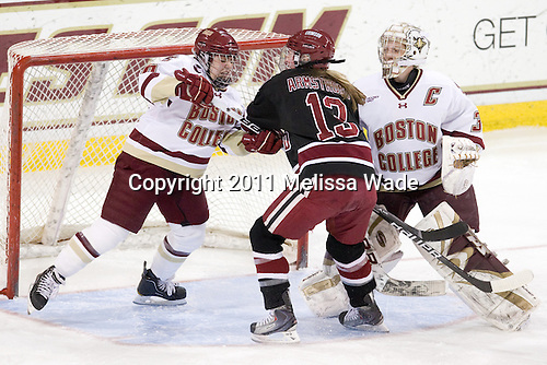 Jessica Martino (BC - 26), Kalley Armstrong (Harvard - 13), Molly Schaus (BC - 30) - The Boston College Eagles defeated the Harvard University Crimson 3-1 to win the 2011 Beanpot championship on Tuesday, February 15, 2011, at Conte Forum in Chestnut Hill, Massachusetts.