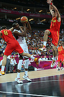 12.08.2012. London, England. Deron Williams takes the jump shot under pressure from CalderÛn, JosÈ in the Mens Basketball Gold Medal Match between USA and Spain London 2012 Olympic Games USA won the game by a score of 107-100 and took the gold medal