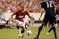 Gabriel Obertan (26) of Manchester United plays the ball away from Toni Stahl (12) of the Philadelphia Union. Manchester United (EPL) defeated the Philadelphia Union (MLS) 1-0 during an international friendly at Lincoln Financial Field in Philadelphia, PA, on July 21, 2010.