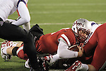 Jeff Tuel, Washington State sophomore quarterback, launches himself in to the endzone during the Apple Cup Pac-10 conference battle against arch-rival Washington at Martin Stadium in Pullman, Washington, on December 4, 2010.  The Huskies prevailed in the contest by scoring a late touchdown to break a 28-28 tie to win, 35-28.