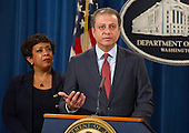 United States Attorney General Loretta E. Lynch, left, looks on as US Attorney Preet Bharara of the Southern District of New York makes opening remarks during a press conference at the Department of Justice in Washington, DC on Thursday, March 24, 2016.  They announced criminal charges against seven individuals working on behalf of the Iranian government for conducting cyber attacks against the US financial sector and the Bowman Dam in Rye, NY.<br /> Credit: Ron Sachs / CNP<br /> (RESTRICTION: NO New York or New Jersey Newspapers or newspapers within a 75 mile radius of New York City)