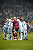 Sporting KC players in a huddle prior to the game... Sporting Kansas City defeated New England Revolution 3-0 at LIVESTRONG Sporting Park, Kansas City, Kansas.