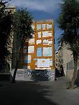 An empty urban street with grafitti