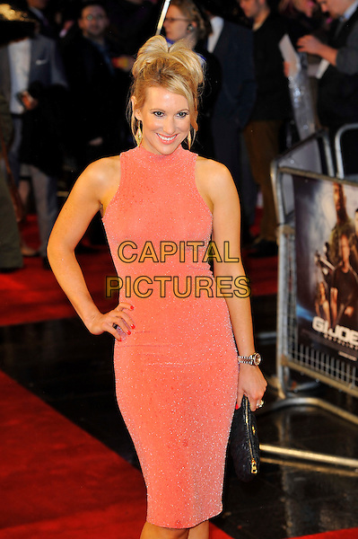 "Rebecca Ferdinando.The ""G.I. Joe 2: Retaliation"" UK film premiere, Empire cinema, Leicester Square, London, England..March 18th, 2013.half length pink sleeveless dress black clutch bag hand on hip see through thru nipples .CAP/MAR.© Martin Harris/Capital Pictures."