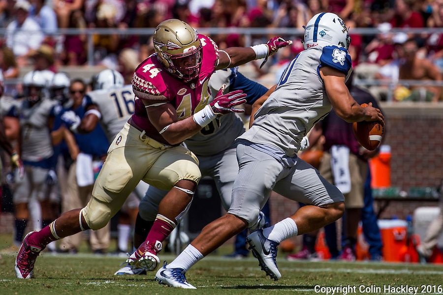 TALLAHASSEE, FLA 9/10/16-Florida State's DeMarcus Walker pressures Charleston Southern quarterback Robert Mitchell during first quarter action Saturday at Doak Campbell Stadium in Tallahassee. <br /> COLIN HACKLEY PHOTO