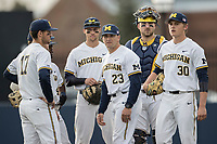 Michigan Wolverines head coach Erik Bakich (23) waits with his players at the mound during a pitching change against the Michigan State Spartans during the NCAA baseball game on April 18, 2017 at Ray Fisher Stadium in Ann Arbor, Michigan. Michigan defeated Michigan State 12-4. (Andrew Woolley/Four Seam Images)