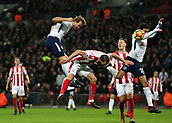 9th December 2017, Wembley Stadium, London England; EPL Premier League football, Tottenham Hotspur versus Stoke City; Harry Kane of Tottenham Hotspur heads the ball over Kevin Wimmer of Stoke City to score his sides 3rd goal to make it 3-0
