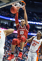 NWA Democrat-Gazette/BEN GOFF @NWABENGOFF<br /> Daniel Gafford, Arkansas forward, dunks on Dontay Bassett (21), Florida forward, in the first half Thursday, March 14, 2019, during the second round game in the SEC Tournament at Bridgestone Arena in Nashville.