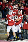 Wisconsin Badgers running back Bradie Ewing (34) and wide receiver Jared Abbrederis (4) celebrate James White (20) touchdown run during an NCAA college football game against the Northwestern Wildcats on November 27, 2010 at Camp Randall Stadium in Madison, Wisconsin. The Badgers won 70-23. (Photo by David Stluka)