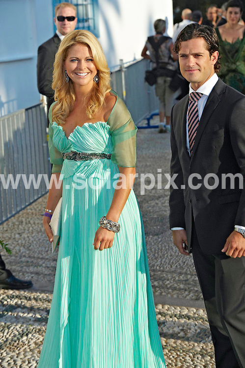 **ALL ROUND PICTURES FROM SOLARPIX.COM**.**SYNDICATION RIGHTS FOR UK AND SPAIN ONLY**.Wedding of Prince Nikolaos and Miss Tatiana Blatnik at the Saint Nikolaos church in Spetses, Greece. 25 August 2010..This pic: Princess Madeleine and Prince Carl Philip..JOB REF: 11994 CPR Kongsted  DATE: 25_08_2010.**MUST CREDIT SOLARPIX.COM OR DOUBLE FEE WILL BE CHARGED**.**MUST NOTIFY SOLARPIX OF ONLINE USAGE**.**CALL US ON: +34 952 811 768 or LOW RATE FROM UK 0844 617 7637**