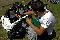"A man paint frames of the saint Laura of Saint Catherine of Siena known as ""Madre Laura"" near her mausoleum in Jerico, Colombia. May 12, 2013. Photo by Freddy Builes / VIEWpress."
