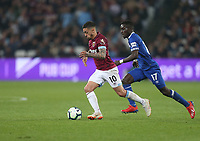 West Ham United's Manuel Lanzini and Everton's Idrissa Gueye<br /> <br /> Photographer Rob Newell/CameraSport<br /> <br /> The Premier League - West Ham United v Everton - Saturday 30th March 2019 - London Stadium - London<br /> <br /> World Copyright © 2019 CameraSport. All rights reserved. 43 Linden Ave. Countesthorpe. Leicester. England. LE8 5PG - Tel: +44 (0) 116 277 4147 - admin@camerasport.com - www.camerasport.com