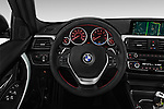 Car pictures of steering wheel view of a 2018 BMW 3-Series 330e-iPerformance 4 Door Sedan Steering Wheel