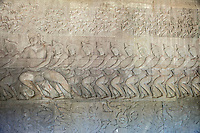 Cambodia, Angkor Wat.  Gods Churning the Sea of Milk, from the Hindu Creation Myth, the Bhagavata-Purana.  Rahu, an asura in disguise among the devas.  Apsaras dance above them. 12th. Century.
