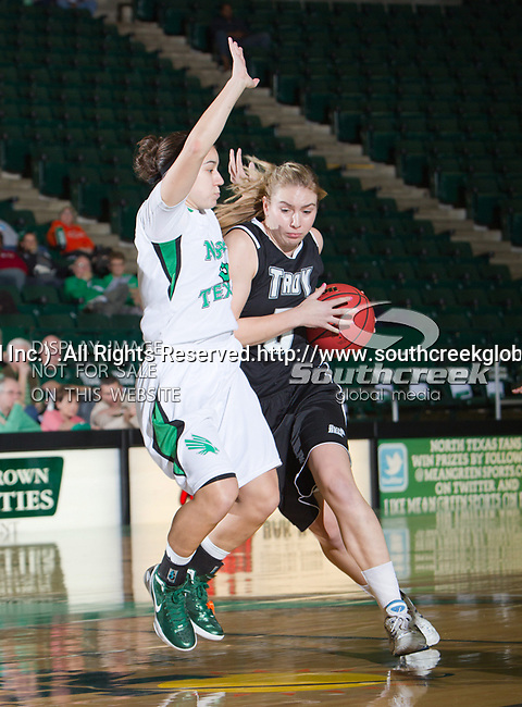 Troy Trojans guard Sarah McAppion (5) and North Texas Mean Green guard Brittney Hudson (5) in action during the game between the Troy Trojans and the University of North Texas Mean Green at the North Texas Coliseum,the Super Pit, in Denton, Texas. UNT defeats Troy 57 to 36.