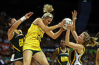17.10.2012 Australia's Catherine Cox and South Africa's Adele Niemand and Karla Mostert in action during the Australia v South Africa netball test match as part of the Quad Series played in Newcastle Australia. Mandatory Photo Credit ©Michael Bradley.