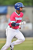 Asheville Tourists right fielder Marcos Derkes (2) runs to first during a game against the Rome Braves on May 15, 2015 in Asheville, North Carolina. The Braves defeated the Tourists 6-0. (Tony Farlow/Four Seam Images)