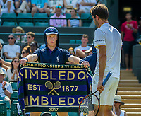 London, England, 6 th July, 2017, Tennis,  Wimbledon, Gilles Simon (FRA) recieves a towel from a ballboy<br /> Photo: Henk Koster/tennisimages.com