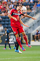 Marco Pappa (16) of the Chicago Fire and Michael Farfan (21) of the Philadelphia Union go up for a header. The Chicago Fire defeated the Philadelphia Union 3-1 during a Major League Soccer (MLS) match at PPL Park in Chester, PA, on August 12, 2012.
