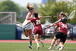 RICHMOND, VA - APRIL 27: Notre Dame's Grace Miller (left) scores a goal past Boston College's Zoe Ochoa (32) and Brooke Troy (28). The Notre Dame Fighting Irish played the Boston College Eagles on April 27, 2017, at Sports Backers Stadium in Richmond, VA in an ACC Women's Lacrosse Tournament quarterfinal match. Boston College won the game 17-14.