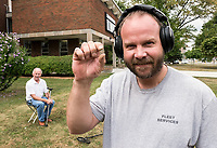 "Home for a visit with family and friends, Trevor Harper, of Edmonton isn't one to sit around. Armed with his metal detector he search the front lawn of Great Lakes Secondary School while his father Allan looked on. During his search he found several coins and a five year Sarnia General Hospital volunteer service pin. ""It's nothing to get rich on, but it's fun and keeps us busy,"" Trevor said adding that it keeps him and his son, Justin, 16, busy searching for buried treasure. (He is also visiting his mom, Barb McBride, the retired classified manager of the Sarnia Observer)"