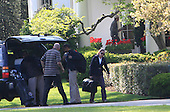As Aides unpack gear, United States President Barack Obama returns to the Oval Office after a Sunday afternoon of golf on Sunday, April 1, 2012. .Credit: Dennis Brack / Pool via CNP
