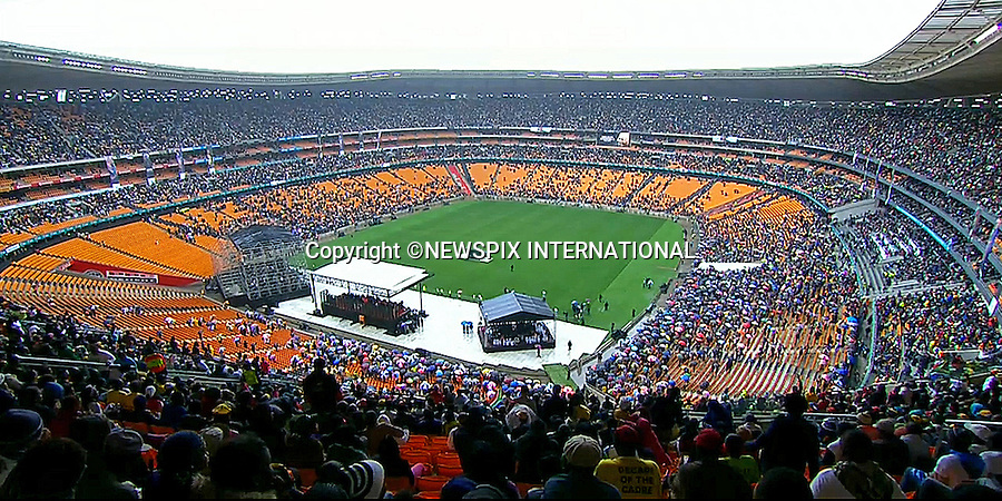 NELSON MANDELA MEMORIAL<br /> The nation mourns Nelson Rolihlahla Mandela Memorial Service, FNB Stadium, Johannesburg, South Africa<br /> Mandatory Credit Photo: &copy;NEWSPIX INTERNATIONAL<br /> <br /> **ALL FEES PAYABLE TO: &quot;NEWSPIX INTERNATIONAL&quot;**<br /> <br /> IMMEDIATE CONFIRMATION OF USAGE REQUIRED:<br /> Newspix International, 31 Chinnery Hill, Bishop's Stortford, ENGLAND CM23 3PS<br /> Tel:+441279 324672  ; Fax: +441279656877<br /> Mobile:  07775681153<br /> e-mail: info@newspixinternational.co.uk