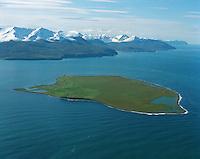 Flatey, Skjálfandi, Víkurfjall í baksýni, Loftmynd..Flaey island on Skjalfandi bay. Vikurfjall mountainrange in background. Aerial