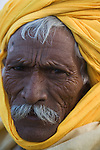 Rajasthani man in yellow turban at Pushkar camel fair; portrait;.The annual Pushkar camel fair is one of the main tourist attractions in India, Pushkar, Rajasthan, India --- Model Released