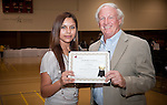Scholarship award winner Iris Medina holds $1000 award certificate with donor Stan St. Pierre.