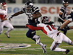 Nevada's Stefphon Jefferson (25) breaks a tackle from Fresno State's Phillip Thomas (16) during the first half of an NCAA college football game in Reno, Nev., on Saturday, Nov. 10, 2012. (AP Photo/Cathleen Allison)