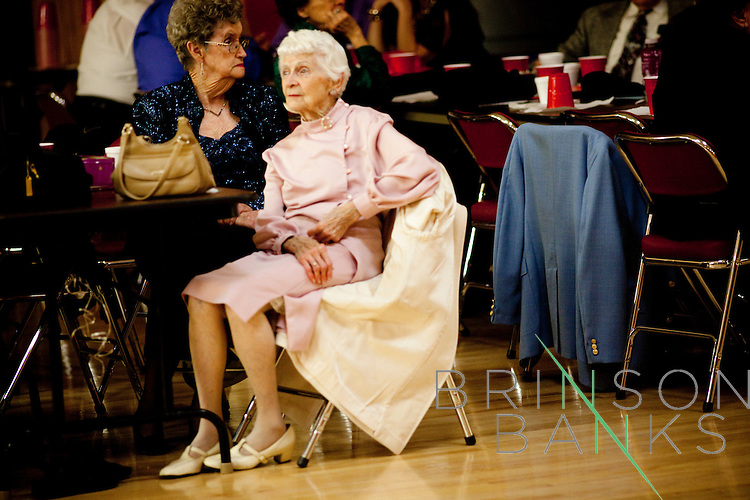 Women sit out a dance at the Singles Dance at the Sundial Auditorium in Sun City Friday night, January 8, 2010.