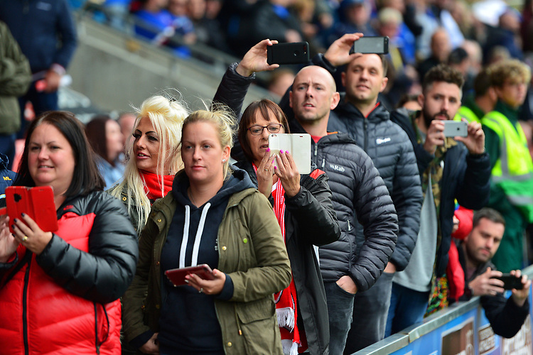 Fleetwood Town fans look on with their mobile phones<br /> <br /> Photographer Richard Martin-Roberts/CameraSport<br /> <br /> The EFL Sky Bet League One - Fleetwood Town v Ipswich Town - Saturday 5th October 2019 - Highbury Stadium - Fleetwood<br /> <br /> World Copyright © 2019 CameraSport. All rights reserved. 43 Linden Ave. Countesthorpe. Leicester. England. LE8 5PG - Tel: +44 (0) 116 277 4147 - admin@camerasport.com - www.camerasport.com