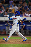 Buffalo Bisons third baseman Vladimir Guerrero Jr. (27) hits a home run in the top of the seventh inning during a game against the Syracuse Chiefs on September 2, 2018 at NBT Bank Stadium in Syracuse, New York.  Syracuse defeated Buffalo 4-3.  (Mike Janes/Four Seam Images)