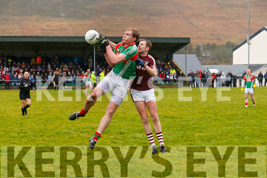 Mid field clash between St Michaels/Foilmores Mark McCarthy & Dromids Caoimhín Ó Laoire.