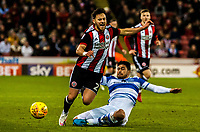 Queens Park Rangers midfielder Massimo Luongo (21) tackles Sheffield United's defender George Baldock (2) during the Sky Bet Championship match between Sheff United and Queens Park Rangers at Bramall Lane, Sheffield, England on 20 February 2018. Photo by Stephen Buckley / PRiME Media Images.