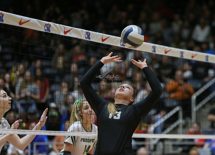 Rouse Raiders senior Maddie Sheehan (13) sets the ball during the Class 5A high school volleyball state final between Rouse High School and Prosper High School at Curtis Culwell Center in Garland, Texas, on November 18, 2017. Prosper won the match in five sets, (25-18, 21-25, 18-25, 25, 23, 16-14) to win the 5A state championship.