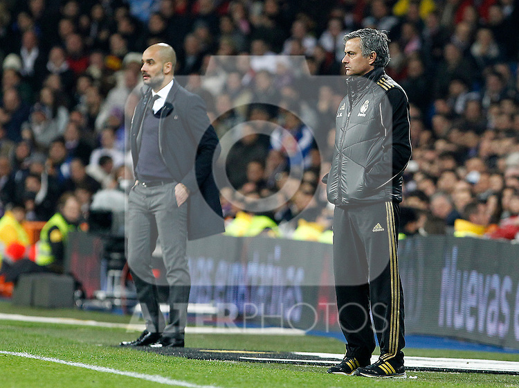 Real Madrid's coach Jose Mourinho (r) and FC Barcelona's coach Pep Guardiola during Spanish King's Cup match.January 18,2011. (ALTERPHOTOS/Acero)