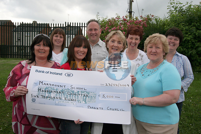 Marymount Girls NS Parents Council, Karen Farrell (secretary), Frank Condra (chairperson), Maria Torpey, Jacqueline Condra (chairperson), Lisa Cummins (treasurer), Lisa Shevlin (treasurer)and Margaret McKeown present a cheque for EUR5000 to school Principal Miss Clinton.  The money was raised at various events, bag packing in Dunnes and Tesco, a Crazy Hair Day and raffles...Photo NEWSFILE/Jenny Matthews.(Photo credit should read Jenny Matthews/NEWSFILE)....This Picture has been sent you under the condtions enclosed by:.Newsfile Ltd..The Studio,.Millmount Abbey,.Drogheda,.Co Meath..Ireland..Tel: +353(0)41-9871240.Fax: +353(0)41-9871260.GSM: +353(0)86-2500958.email: pictures@newsfile.ie.www.newsfile.ie.FTP: 193.120.102.198.