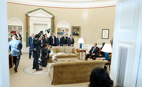 Staff traveling with Prime Minister Nouri al-Maliki of Iraq look on during a photo op prior to his meeting with United States President Barack Obama meets  in the Oval Office of the White House, Monday, December 12, 2011 in Washington, DC..Credit: Olivier Douliery / Pool via CNP