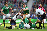 Tommy Bowe of Ireland takes on the Romania defence. Rugby World Cup Pool D match between Ireland and Romania on September 27, 2015 at Wembley Stadium in London, England. Photo by: Patrick Khachfe / Onside Images