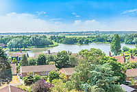 BNPS.co.uk (01202 558833)<br /> Pic: Savills/BNPS<br /> <br /> Views over the Meare, a local nature reserve.<br /> <br /> Water View...Former water tower near Aldeburgh in Suffolk<br /> <br /> A huge six storey former water tower which resembles a castle gate house has emerged on to the market for £1million.<br /> <br /> Grade II listed West Bar, in Thorpeness, provides the perfect vantage point to take in breathtaking views of the Suffolk coast.<br /> <br /> It was designed by architect William Gilmour Wilson in the 1920s in a mock tudor style, with mullioned windows and parapets.<br /> <br /> The six storey, five bedroom property, boasting distinctive full length windows and open fireplaces, has two spacious 'tower' rooms.<br /> <br /> The water tanks were taken out by the deceased owner about 20 years ago. It is being sold with estate agent Savills by his children.