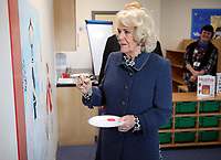 06 February 2019 - Camilla Duchess of Cornwall helps to finish a mural in the new library during a visit to St John's Angell Town Church of England Primary School  in London. Photo Credit: ALPR/AdMedia