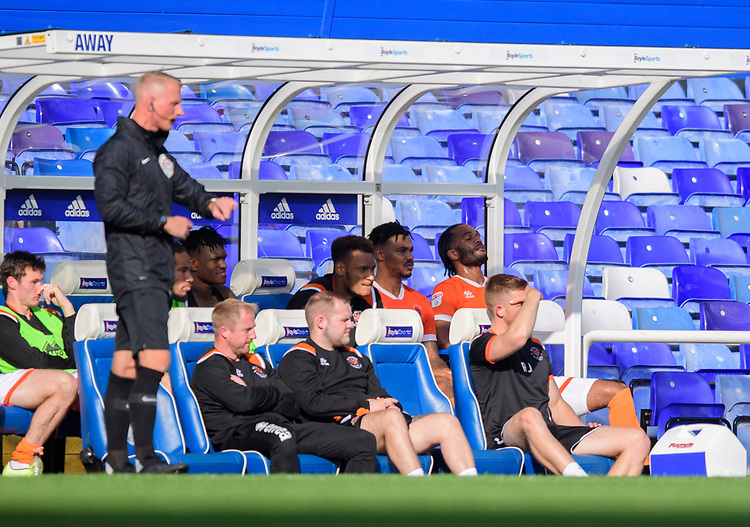 Blackpool's Nathan Delfouneso, back right, sits in the dug-out after he was forced off with an injury<br /> <br /> Photographer Chris Vaughan/CameraSport<br /> <br /> The EFL Sky Bet League One - Coventry City v Blackpool - Saturday 7th September 2019 - St Andrew's - Birmingham<br /> <br /> World Copyright © 2019 CameraSport. All rights reserved. 43 Linden Ave. Countesthorpe. Leicester. England. LE8 5PG - Tel: +44 (0) 116 277 4147 - admin@camerasport.com - www.camerasport.com