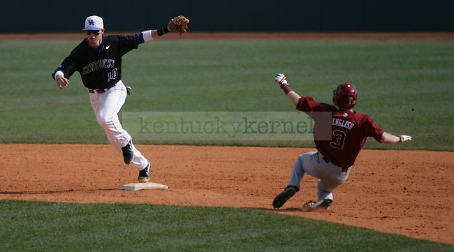 Second baseman J.T. Riddle gets out a runner on second base during the final game of the UK vs. South Carolina series in Lexington, Ky., on 3/18/12. Photo by Brandon Goodwin | Staff